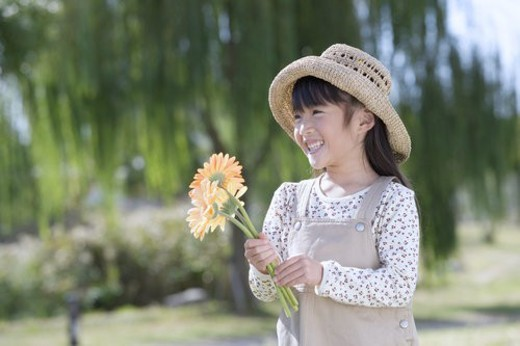 Stock Photo: 4029R-312392 A Girl With A Flower