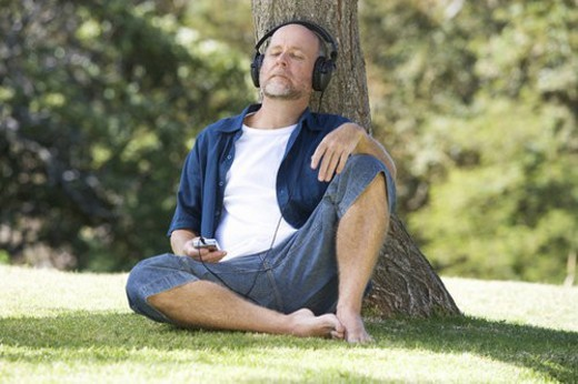 Stock Photo: 4029R-314207 A senior man listening to music