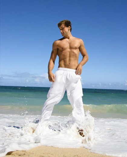Physically fit shirtless man standing on Maui, Hawaii beach. : Stock Photo