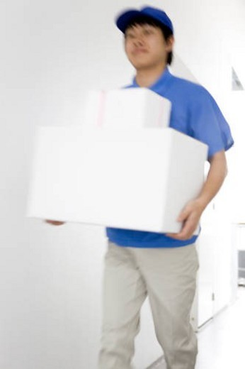 Stock Photo: 4029R-31961 Delivery man carrying package