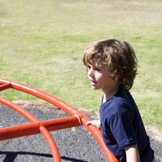 A young boy on a playground : Stock Photo