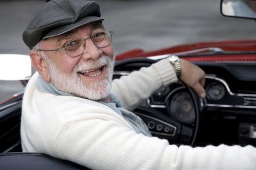 Stock Photo: 4029R-321842 A senior man driving a sports car