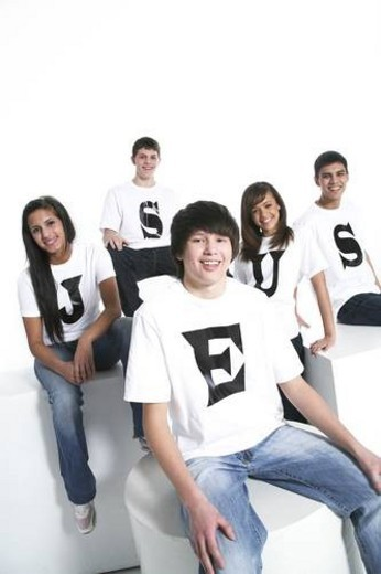 Stock Photo: 4029R-323847 Five teenagers with t-shirts spelling Jesus
