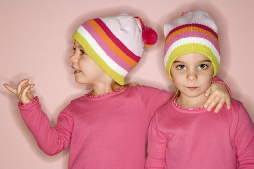 Young female twin Caucasian children standing together. : Stock Photo