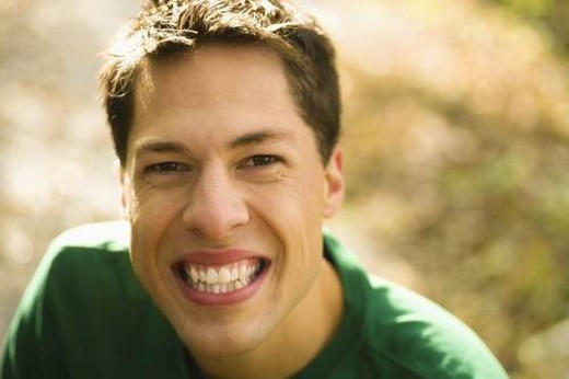 Stock Photo: 4029R-324140 willmar, minnesota, united states of america; a young man with a big smile