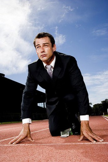 Stock Photo: 4029R-324420 Portrait of a businessman on the starting blocks