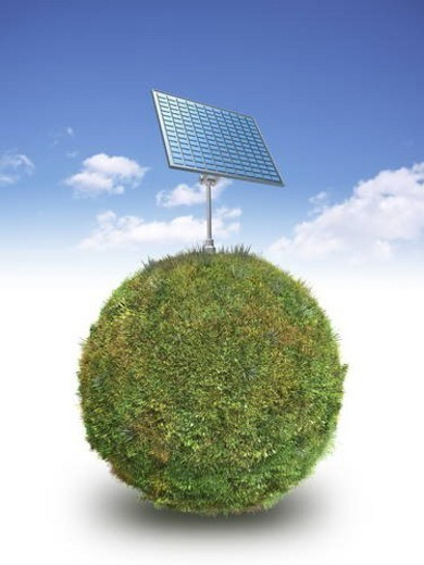 Solar panel on grass covered sphere : Stock Photo