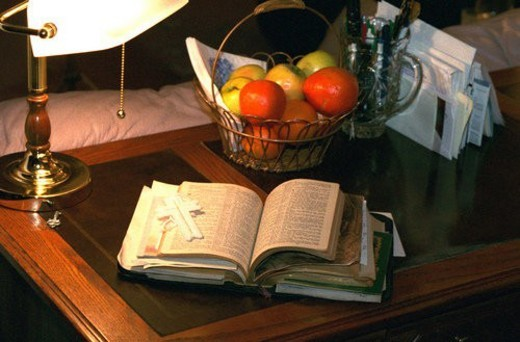 Open bible and fruit basket on desk : Stock Photo