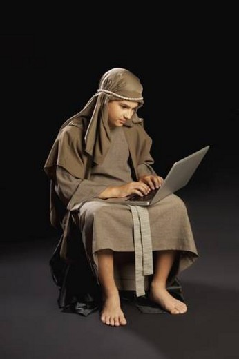 young jesus using a laptop : Stock Photo