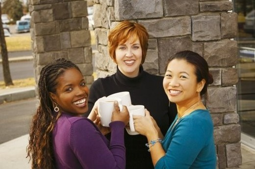 Stock Photo: 4029R-326820 Three women celebrating together