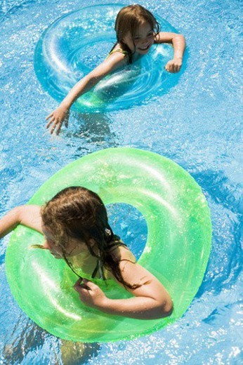 Children playing in pool : Stock Photo