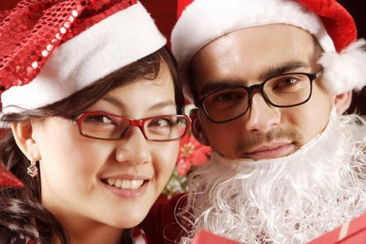 Stock Photo: 4029R-328829 A portrait of Santa Claus andyoung woman