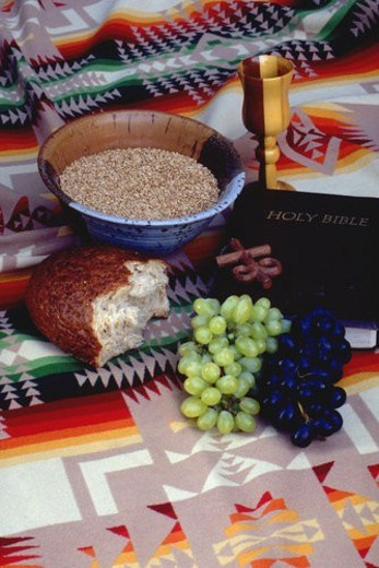 Wheat bread grapes cross chalice and bible on Navajo blanket : Stock Photo
