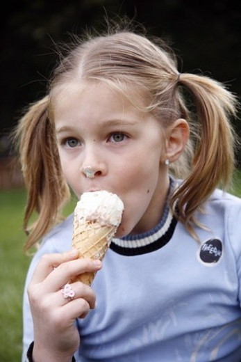 Stock Photo: 4029R-329428 Young girl eating ice cream