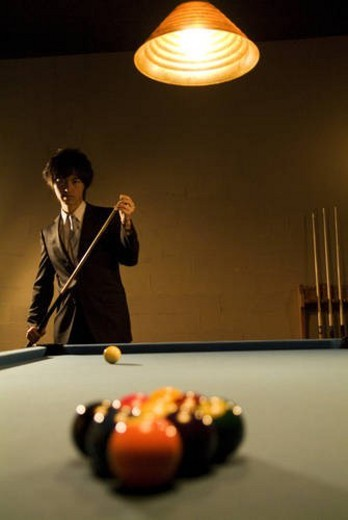 Stock Photo: 4029R-329740 Businessman playing pool