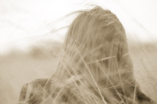 Woman s hair blowing : Stock Photo