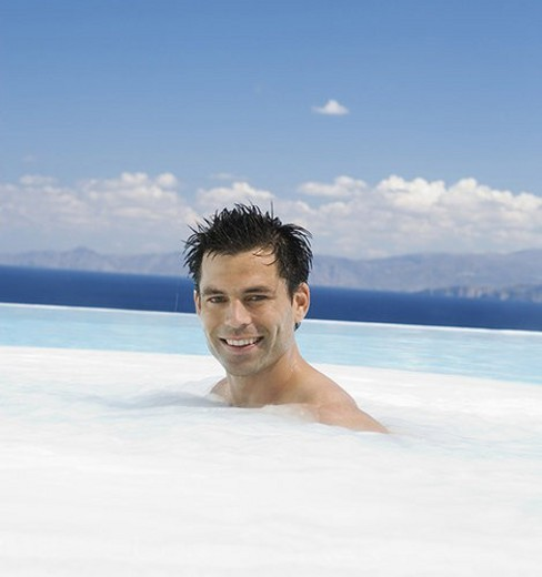 A man relaxing in a jacuzzi : Stock Photo
