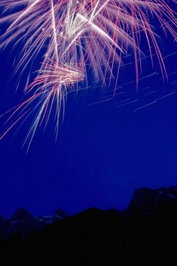 Fireworks over the mountains : Stock Photo
