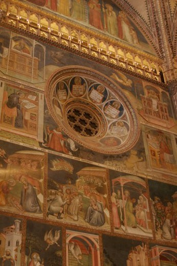detail of side wall of apse frescoes and illuminated balcony, with central rosette window : Stock Photo