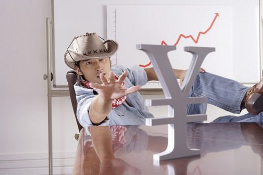 Cowboy reaching for RMB symbol : Stock Photo