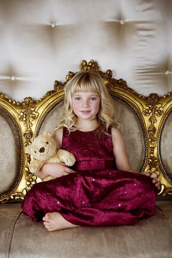 Portrait of a little girl holding a teddy bear : Stock Photo