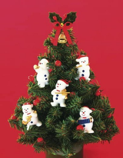 Stock Photo: 4029R-336928 Miniature Christmas tree decorated with snowmen figurines