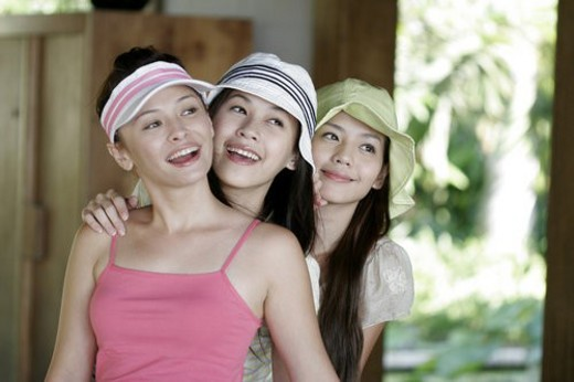 View of young women standing and laughing. : Stock Photo
