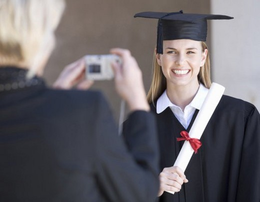 Stock Photo: 4029R-341150 A graduate posing for a family photograph