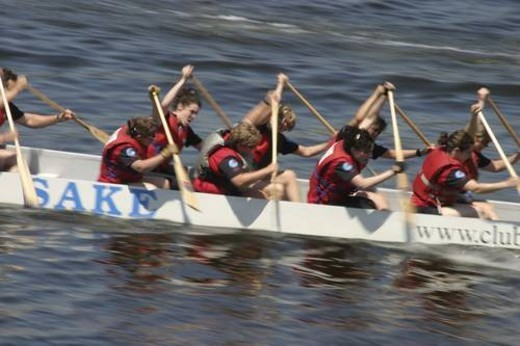 dragon boat racing in Vancouver British Columbia. There are up to 22 people in a boat. Dragon boat racing is largely used as a team building activitey for companies. As well, dragon boat races usually : Stock Photo