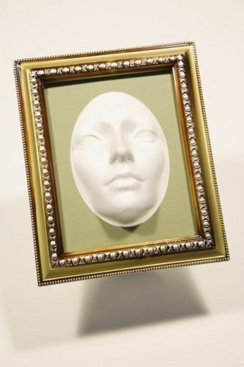 Stock Photo: 4029R-346740 Mask in a picture frame