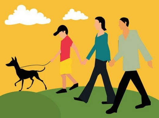Side view of family walking with their pet : Stock Photo