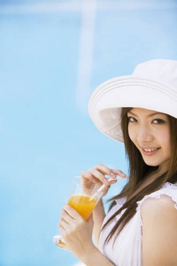 Young woman drinking orange juice : Stock Photo
