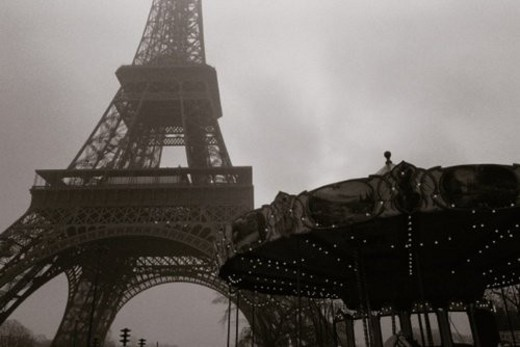 Stock Photo: 4029R-351591 Image of the Eiffel Tower and a Carousel Under a Grey Sky, Low Angle View, Paris, France