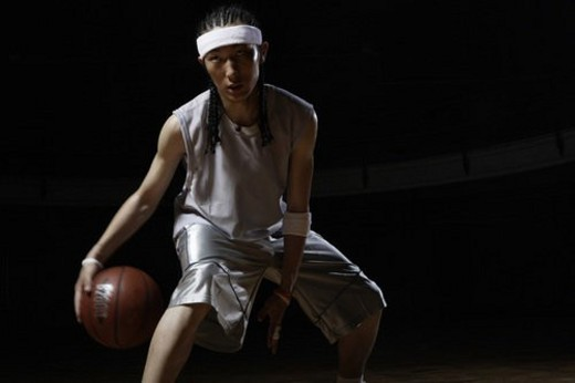 Stock Photo: 4029R-35251 Young man playing basketball