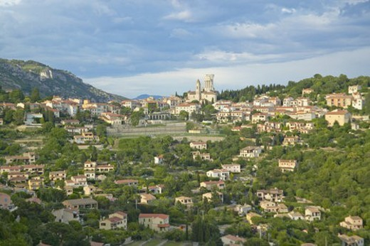 Town of La Turbie with Trophee des Alpes and church : Stock Photo
