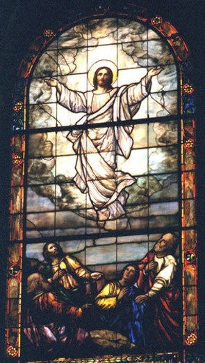Jesus ascending to heaven on stained glass : Stock Photo