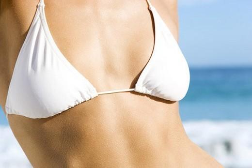 A young woman s torso in bikini top : Stock Photo
