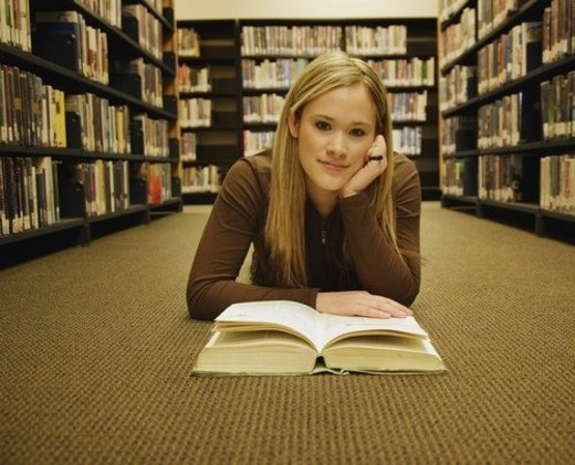Stock Photo: 4029R-36006 Teen in the library