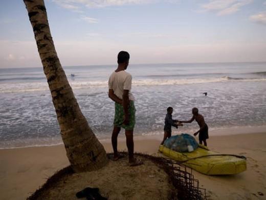 People on the beach of the Arabian Sea : Stock Photo