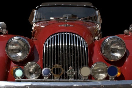 Cut out front view of red Morgan showing hood, headlamps, and grille : Stock Photo