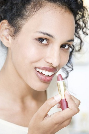 Stock Photo: 4029R-360865 Woman trying on lipstick