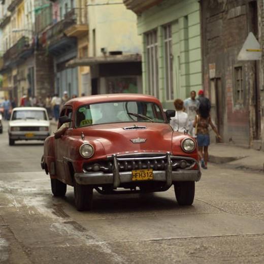 Stock Photo: 4029R-361754 Antique car in a market place, Havana, Cuba