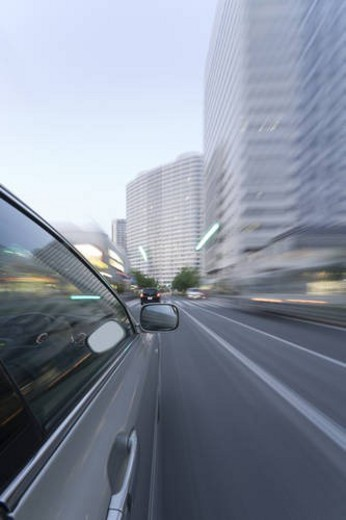 Car driving through the city : Stock Photo