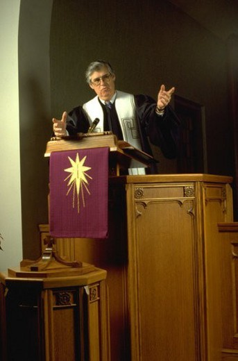 Presbyterian minister preaching from his pulpit : Stock Photo