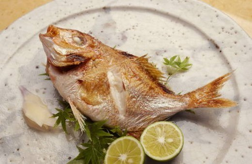 Plate of grilled sea bream, close up : Stock Photo
