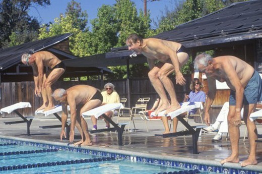 Senior Olympic Swimming competition, Men at starting gate : Stock Photo