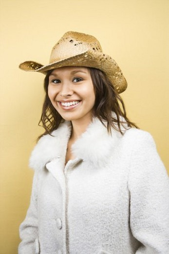 Stock Photo: 4029R-368730 Young adult Caucasian woman wearing cowboy hat smiling at viewer.