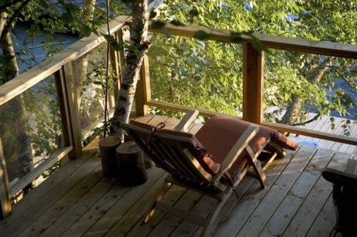 Lake of the Woods, Ontario, Canada; Chair on a deck : Stock Photo