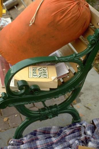Stock Photo: 4029R-370496 Bible and sleeping bag on a bench