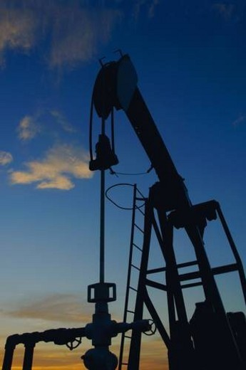 Silhouette of oil pump : Stock Photo